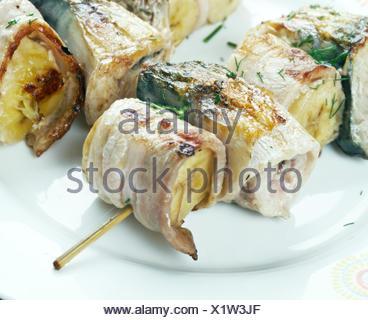 kebabs mackerel, banana and bacon - Stock Photo