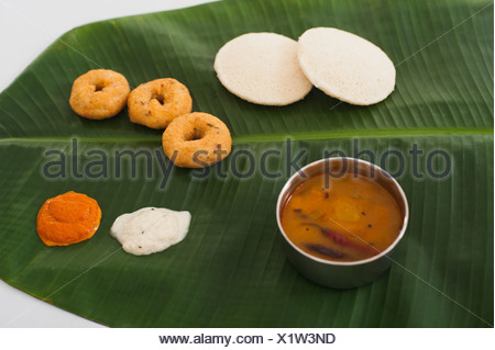South Indian food served on a banana leaf - Stock Photo