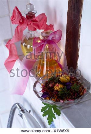 Pot pouri on shelf with essential oils - Stock Photo