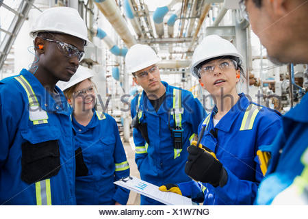 Workers meeting at gas plant - Stock Photo