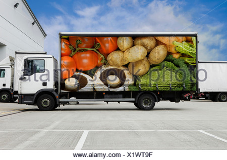 Truck with vegetables parked outside distribution warehouse - Stock Photo