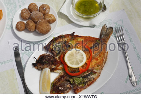 Gilthead seabream, potatoes, papas arrugadas, La Palma, Canary Islands, Spain - Stock Photo