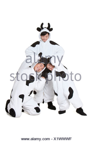 Family in cow costumes playing around - Stock Photo