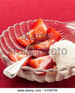 Fresh sliced strawberries in glass dish - Stock Photo