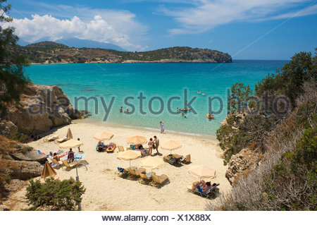 Beach on the Mirambellou Bay in Agios Nikolaos, Crete, Greece, Europe - Stock Photo