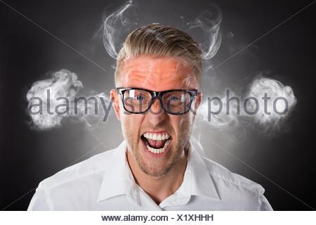 Furious Young Businessman - Stock Photo