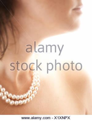 Close-up of a woman wearing pearl necklace - Stock Photo