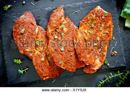 Three Marinated Pork Chops - Stock Photo