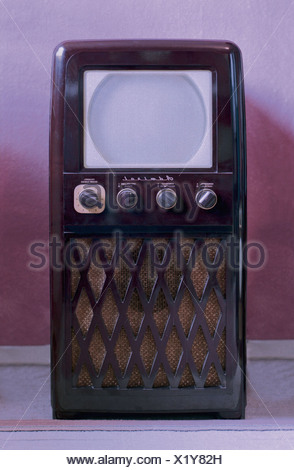 broadcast, television, television set, Admiral 20X122, with 10 inch screen size, chassis: bakelite, USA, 1950, television console, television cabinet, standalone device, round picture tube, telescreen, TV screen, ground glass screen, matt screen, ground glass screens, matt screens, monochrome, monochrome television set, bakelite, bakelite chassis, frontal, design, collectible, collector's item, collectibles, collector's items, rarity, curiosity, curiosities, American television, American, TV history, 50s, television furniture, television set, TV set, TV, televi, Additional-Rights-Clearences-NA - Stock Photo