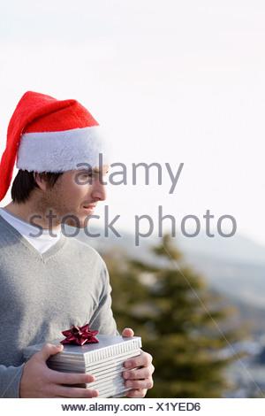 Young man wearing a santa hat - Stock Photo