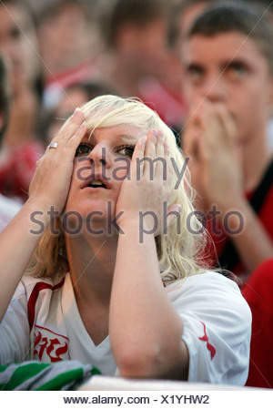 Shocked Supporters of the German soccer team VfB Stuttgart after their team has lost the German Cup final Stuttgart Germany Bad - Stock Photo