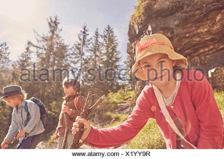 Three children exploring forest - Stock Photo