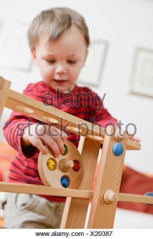 Boy playing skill game - Stock Photo