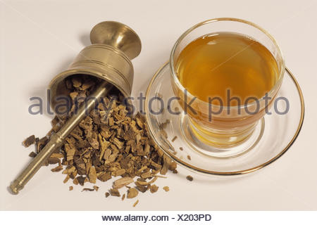 Tea glass, mortar, roots, sweet wooden root tea, Glycyrrhiza glabra, Still life, cut out, glass, teacup, cup, tea, root tea, drink, drinking, infusion drink, alcohol-free, anti-alcoholic, hotly, remedial tea, herb tea, chops up, dryly, medicament tea, Fab - Stock Photo