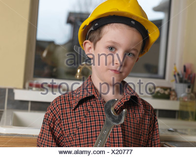 Boy dressed as builder - Stock Photo