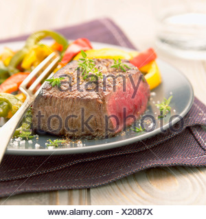 Thick piece of beef with fresh thyme,Fleur de sel sea salt and peppers - Stock Photo