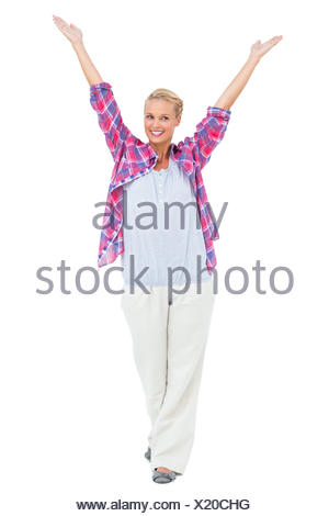 Blonde woman standing with hands up in air - Stock Photo