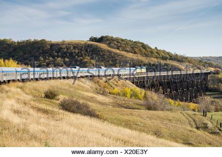 Passenger train going over the Uno trestle bridge in Manitoba, Canada. - Stock Photo