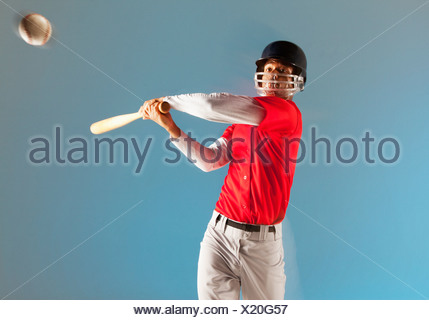 Blurred view of baseball player swinging bat - Stock Photo