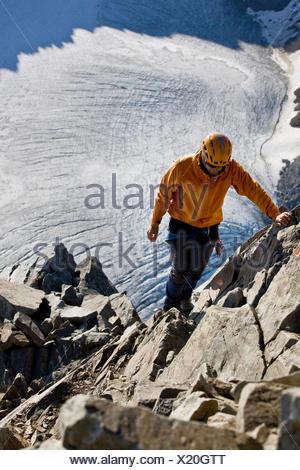 Mountain climber during the ascent of Wilder Pfaff Mountain, Stubai Valley, Stubai Alps, Tyrol, Austria - Stock Photo