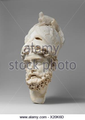 Marble relief fragment with the head of Mars. Period: Mid-Imperial; Date: early 3rd century A.D; Culture: Roman; Medium: Marble; Dimensions: H. 14 - Stock Photo
