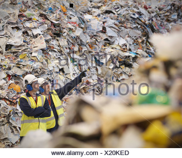 Workers With Paper In Recycle Plant - Stock Photo