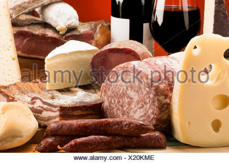 Still life, mixed salami, Mixed cheeses, typical products, red wine, Salami and cheeses, Trentino, AltoAdige, Dolomites, food, - Stock Photo