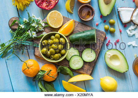 Overhead view of table with various vegetables and fruits - Stock Photo