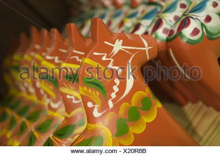 Rows of painted dalarna horses - Stock Photo