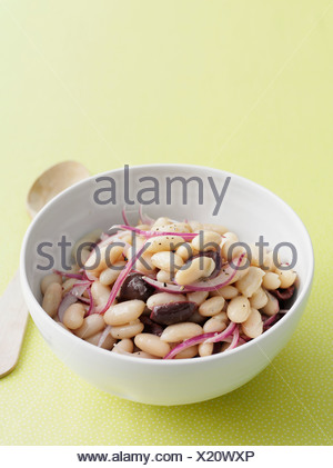Bowl of beans salad with olives - Stock Photo