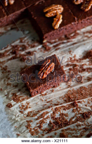 Chocolate brownies with caramelized pecans - Stock Photo