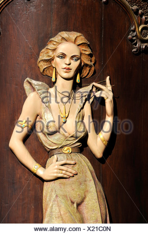 Art Nouveau house emblem of a lascivious woman, wood relief on the facade of the Caffè per Lei Cafe, historic district, Prague - Stock Photo