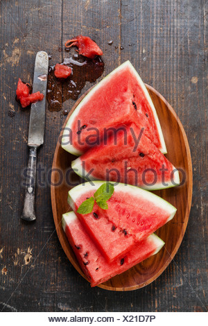Watermelon slices on wooden background - Stock Photo
