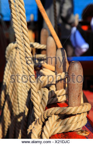 Old boat, hayrack and cleats - Stock Photo