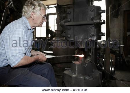 Blacksmith at work - Stock Photo