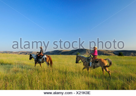Pacific Northwest, American west, Oregon, USA, United States, America, cowgirl, girl, woman, cowboy, prairie, grassland, riding, - Stock Photo