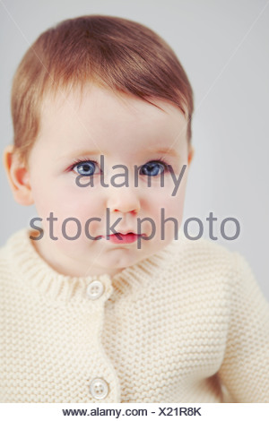 Close up of baby girls face - Stock Photo