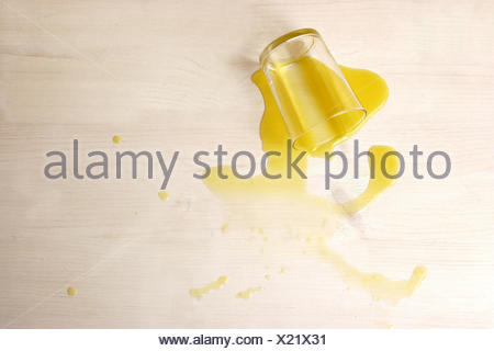 Juice glass, tipped over, - Stock Photo