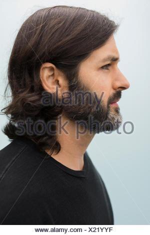 Close up profile portrait brunette bearded man - Stock Photo