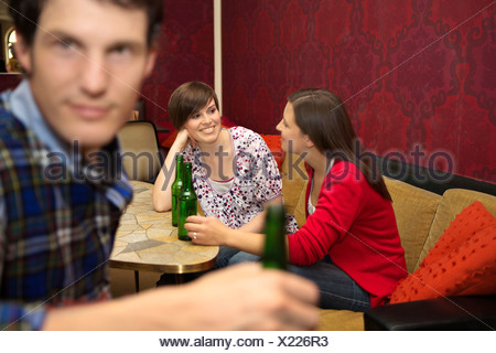 Friends in a bar / restaurant - Stock Photo