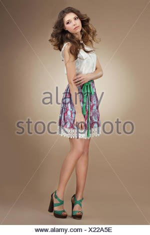 Sentimentality. Elegant Cute Female in Stylish Dress - Stock Photo