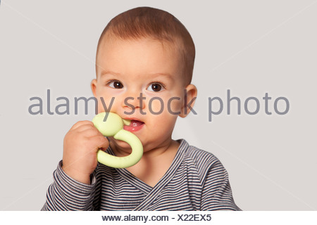 portrait of baby with teething ring - Stock Photo