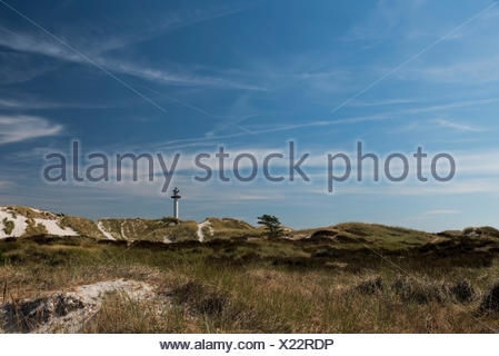 Lighthouse on Bornholm, Denmark, Dueodde Fyr, view about the dunes and Sand to the lighthouse in the horizon, nice summer day with blue heaven and cloud formation, - Stock Photo