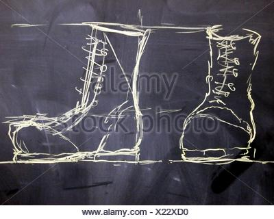 Chalk Drawing freehand two military boots - Stock Photo