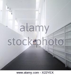Couple Walking In Corridor - Stock Photo
