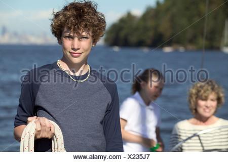 Teenage boy holding rope - Stock Photo