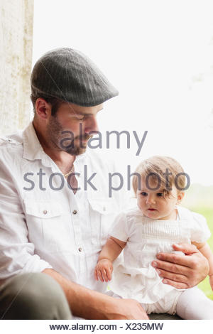 Sweden, Varmland, Filipstad, Gasborn, Horrsjon, Portrait of man with baby girl (12-17 months) - Stock Photo