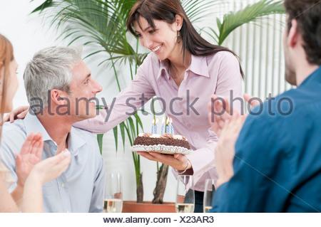 Friends celebrating birthday together - Stock Photo