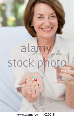cute mature woman with pills stock photo: 35775695 - alamy
