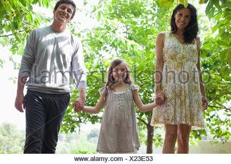 Family holding hands together outdoors - Stock Photo